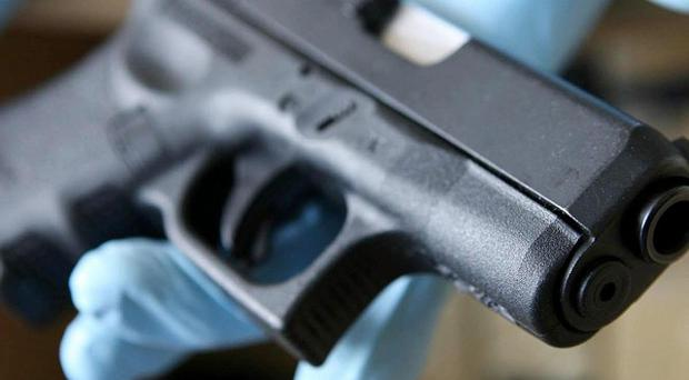 Three men were arrested after a handgun was found in a car at a checkpoint