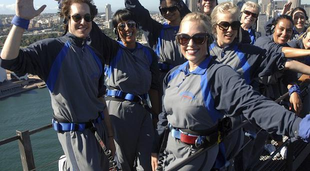 Climbers celebrate the 100th anniversary of International Women's Day on Sydney Harbour Bridge (AP)