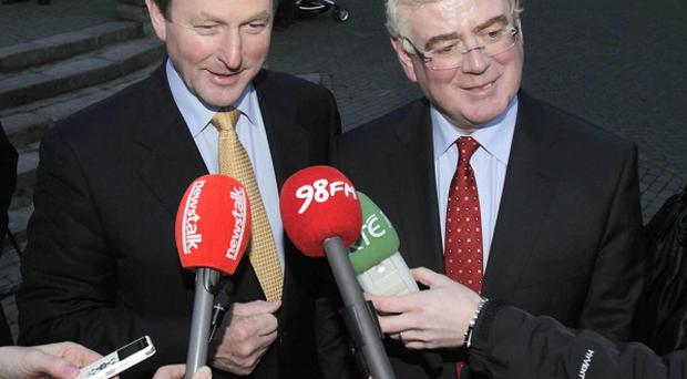 The coalition Government of Fine Gael leader Enda Kenny (left) and Labour leader Eamon Gilmore is set to be sworn in