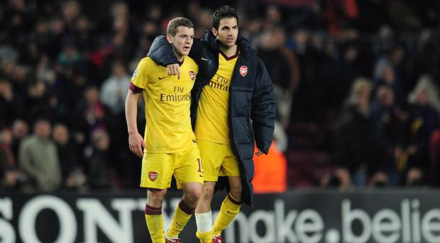 BARCELONA, SPAIN - MARCH 08: Jack Wilshere and Cesc Fabregas of Arsenal leave the field at the end of the UEFA Champions League round of 16 second leg match between Barcelona and Arsenal at the Nou Camp Stadium on March 8, 2011 in Barcelona, Spain. (Photo by Shaun Botterill/Getty Images)
