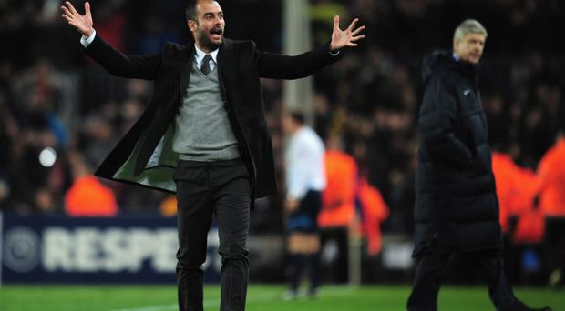 BARCELONA, SPAIN - MARCH 08: Josep Guardiola the Barcelona coach celebrates as Arsene Wenger the Arsenal coach looks on during the UEFA Champions League round of 16 second leg match between Barcelona and Arsenal at the Nou Camp Stadium on March 8, 2011 in Barcelona, Spain. (Photo by Shaun Botterill/Getty Images)
