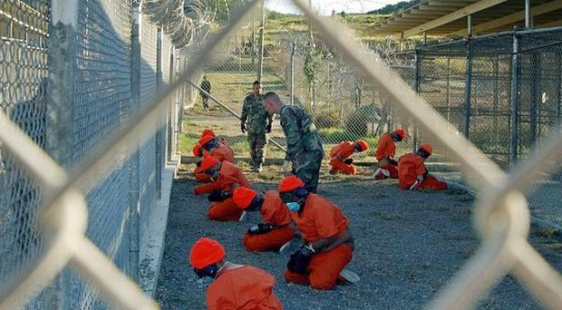 US President Barack Obama has approved the resumption of military trials for detainees at Guantanamo Bay
