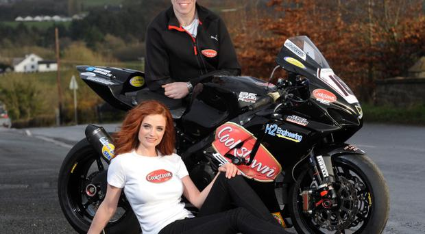 John Burrows, joined by Collette O'Neill, shows off his new bike sponsored by Cookstown