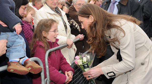 Kate Middleton at Hillsborough Castle chatting with Kate Cherry who presented her with a bouquet of flowers