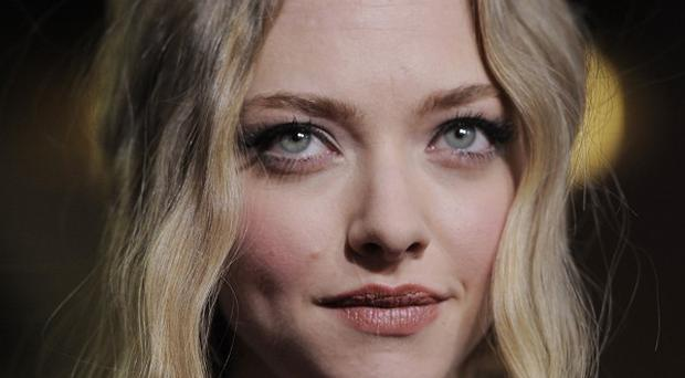 Amanda Seyfried has admitted she found her break up with Dominic Cooper tough