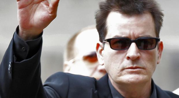 Charlie Sheen lashed out at his former TV bosses after being sacked from Two And A Half Men