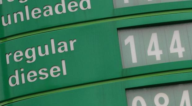 A petrol sign displaying the price of fuel as 140.9p for a litre of unleaded petrol at BP Medway Services on the M2