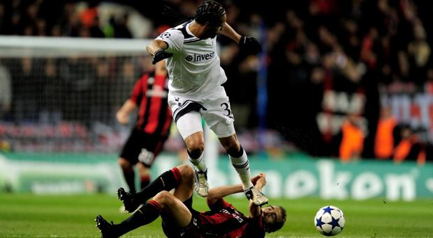 LONDON, ENGLAND - MARCH 09: Benoit Assou-Ekotto of Tottenham jumps over Mathieu Flamini of Milan during the UEFA Champions League round of 16 second leg match between Tottenham Hotspur and AC Milan at White Hart Lane on March 9, 2011 in London, England. (Photo by Jamie McDonald/Getty Images)