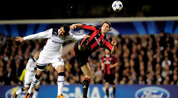 LONDON, ENGLAND - MARCH 09: Sandro (L) of Tottenham clashes with Zlatan Ibrahimovic of Milan during the UEFA Champions League round of 16 second leg match between Tottenham Hotspur and AC Milan at White Hart Lane on March 9, 2011 in London, England. (Photo by Jamie McDonald/Getty Images)