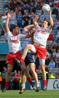 Tyrone's Colm Cavanagh (right) is regaining his best form following a period of suspension
