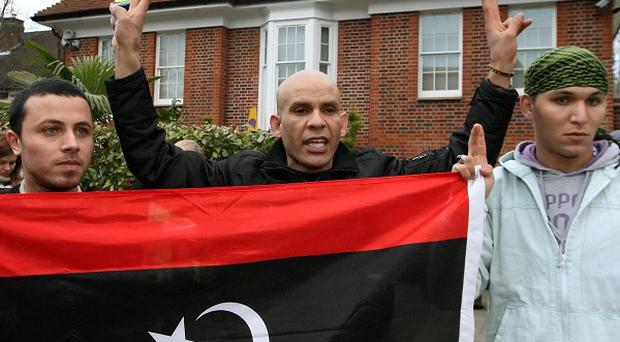 Members of a group calling themselves 'Topple The Tyrants' outside a house thought to belong to Saif al-Islam Gaddafi
