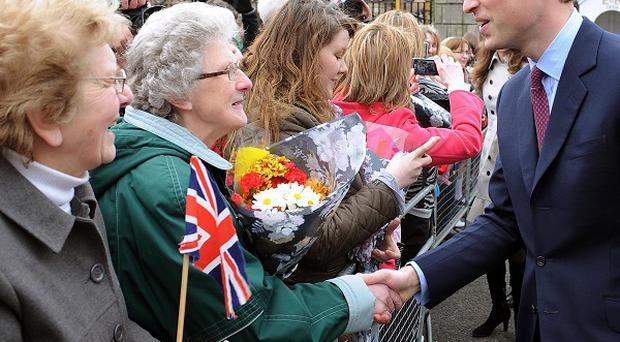Prince William meets well-wishers outside Hillsborough Castle during a visit to Northern Ireland