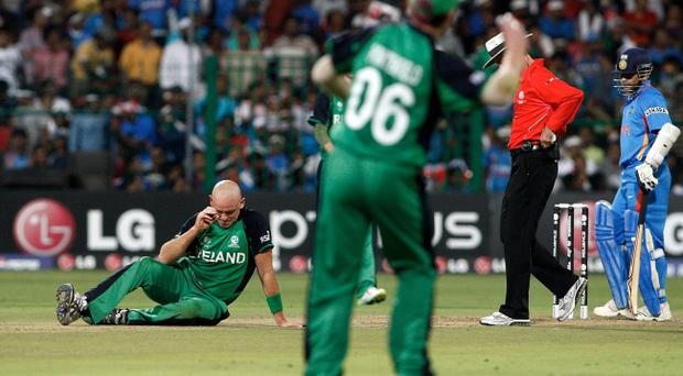 Ireland bowler Trent Johnston (left) hasn't given up hope of featuring against West Indies in the World Cup tomorrow