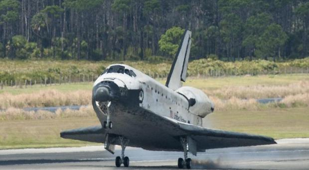 Space shuttle Discovery lands at Kennedy Space Centre (AP/Nasa)