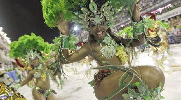 A member of Mocidade Independente samba school performs while parading during carnival celebrations at the Sambadrome in Rio de Janeiro, Brazil, Tuesday, March 8, 2011. (AP Photo/Silvia Izquierdo)