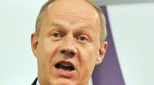 Immigration Minister Damian Green said new centres will have an 'entirely different look and feel' to immigration removal facilities