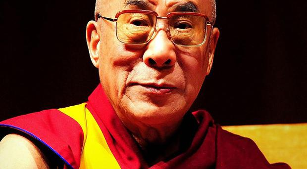 The Dalai Lama will give up his political role in Tibet's government-in-exile