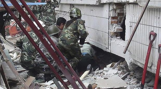 Rescue workers search for victims after an earthquake jolted Yingjiang county in China's Yunnan province (AP)