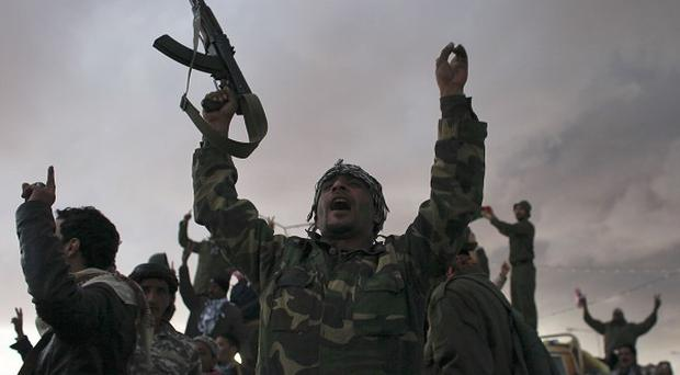Libyan rebels cheer in the eastern town of Ras Lanouf (AP)