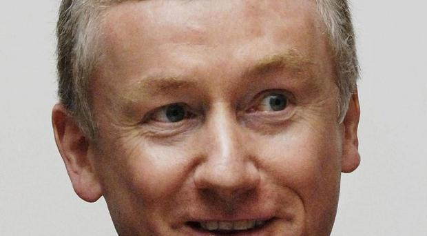 Sir Fred Goodwin has taken out an injunction banning newspapers from calling him a banker, an MP said