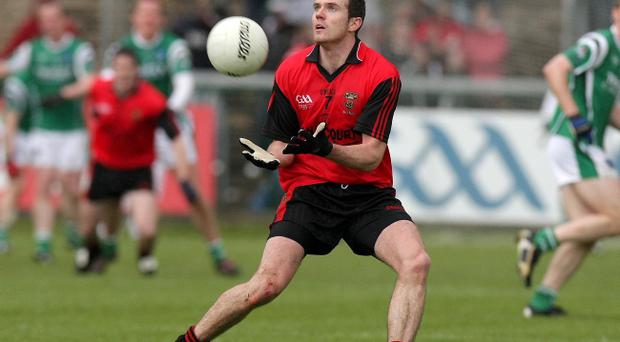 Declan Rooney is one of four Burren players who will help underpin the Down defence against Cork tomorrow night