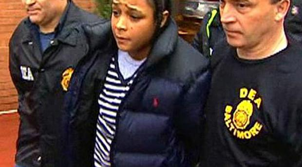 Actress Felicia 'Snoop' Pearson is led away by Drug Enforcement Agency officers after a raid in Baltimore (AP)