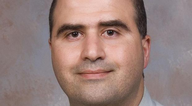 Nidal Malik Hasan's supervisors expressed serious concerns about his questionable behaviour (AP)