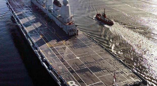 HMS Ark Royal was taken out of service as part of the Government's defence review last year