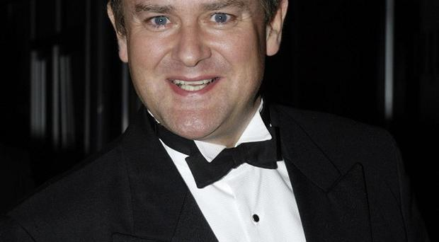 Hugh Bonneville says Downton Abbey has some unlikely fans - including his own son