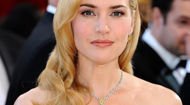 Kate Winslet says she felt she needed to defend her body shape when she was younger