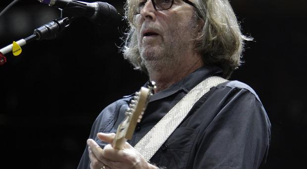 An auction of Eric Clapton's guitars has been held