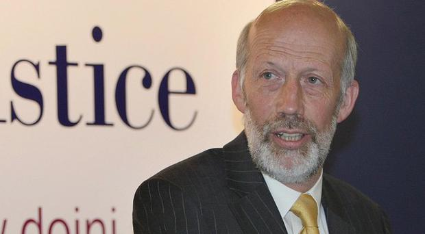 Justice Minister David Ford has said the management of criminal records is to be reviewed