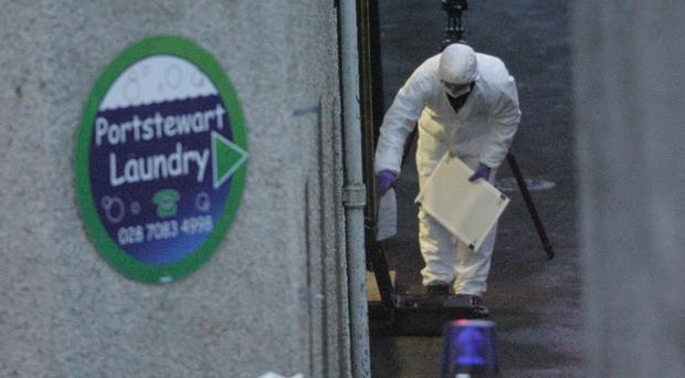 A forensics officer inspects the crime scene