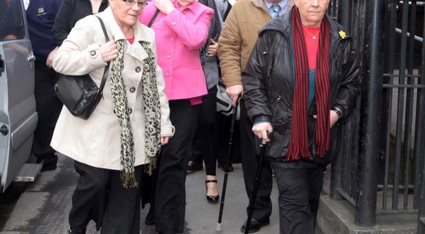 Members of Peter Wilson's family enter the court for the inquest into the Belfast man's death