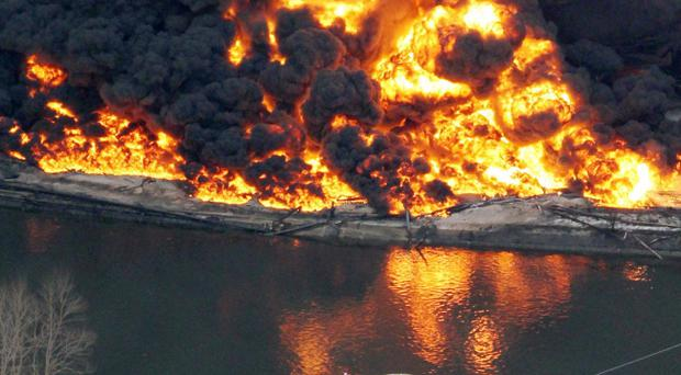 Gas storage facilities burn in Tagajo, Miyagi Prefecture, Saturday morning, March 12, 2011 after Japan's biggest recorded earthquake slammed into its eastern coast Friday