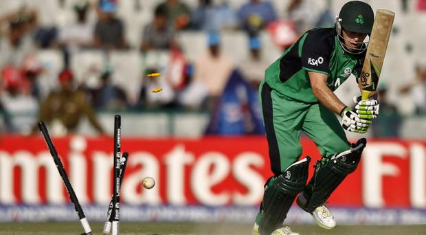 Ed Joyce has his stumps split by Andre Russell during Ireland's 44-run defeat at the hands of the West Indies yesterday in Mohali