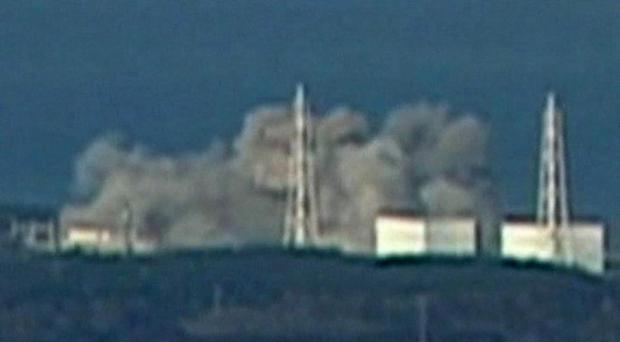 In this video image taken from NTV Japan via APTN, smoke rises from Unit 1 of Fukushima Daiichi nuclear power plant in Okumamachi, Fukushima prefecture, Japan, Saturday, March 12, 2011. Government spokesman Yukio Edano said the explosion destroyed the exterior walls of the building where the reactor is placed, but not the metal housing enveloping the nuclear reactor, however the government has ordered the evacuation of all people within a 12-miles radius of the plant
