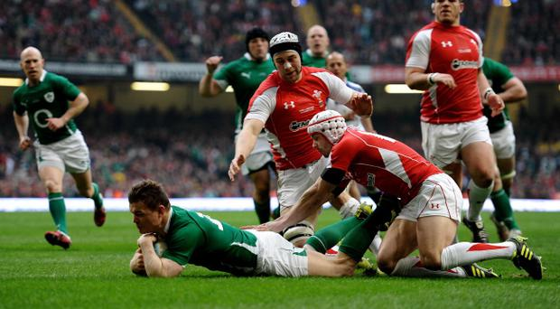 CARDIFF, WALES - MARCH 12: Brian O'Driscoll of Ireland dives over to score the opening try during the RBS Six Nations Championship match between Wales and Ireland at the Millennium Stadium on March 12, 2011 in Cardiff, Wales. (Photo by Laurence Griffiths/Getty Images)