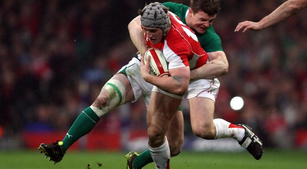 Wales's Jonathan Davies is tackled by Ireland's Brian O'Driscoll during the RBS 6 Nations Match at the Millennium Stadium, Cardiff. PRESS ASSOCIATION Photo. Picture date: Saturday March 12, 2011. See PA Story RUGBYU Wales. Photo credit should read: David Jones/PA Wire. RESTRICTIONS: Use subject to restrictions. Editorial use only. No commercial use. No book use without prior permission. Call +44 (0)1158 447447 for further information.