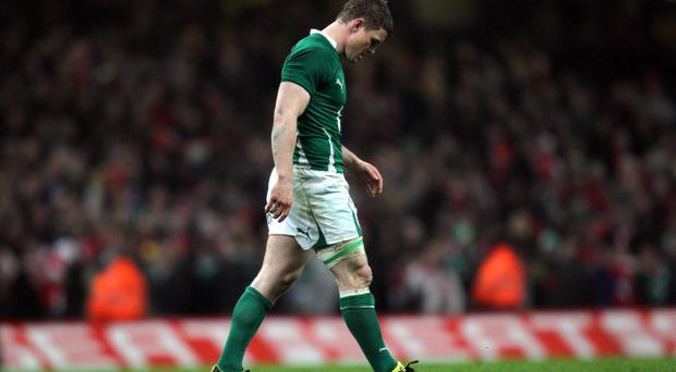 Ireland captain Brian O'Driscoll makes his way off the field at the final whistle during the RBS 6 Nations Match at the Millennium Stadium, Cardiff. PRESS ASSOCIATION Photo. Picture date: Saturday March 12, 2011. See PA Story RUGBYU Wales. Photo credit should read: David Davies/PA Wire. RESTRICTIONS: Use subject to restrictions. Editorial use only. No commercial use. No book use without prior permission. Call +44 (0)1158 447447 for further information.