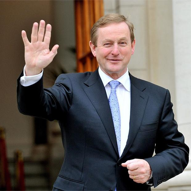 Enda Kenny is attending his first EU summit as Taoiseach, and hopes to discuss easing the terms of Ireland's bail-out