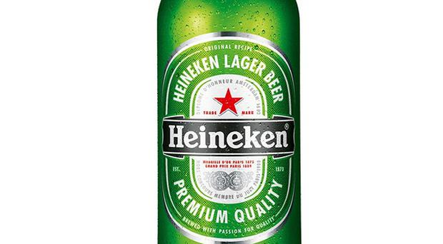 Heineken is to cut the alcohol content of one of its major brands after signing up to a Government deal on public health