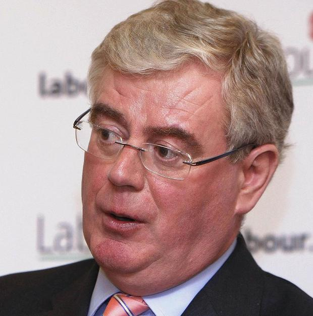 Eamon Gilmore welcomed Amgen's move to save 280 Pfizer jobs