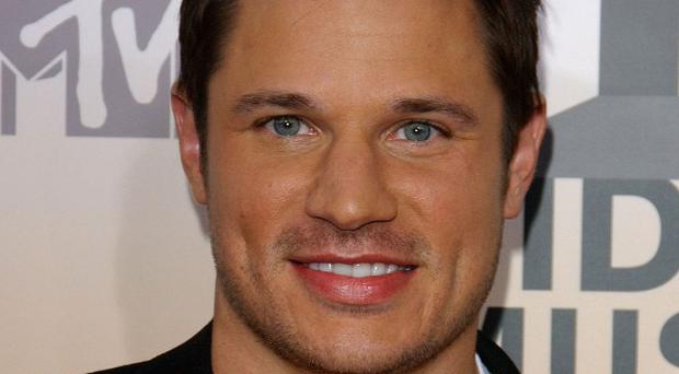Nick Lachey has written his own basketball theme song