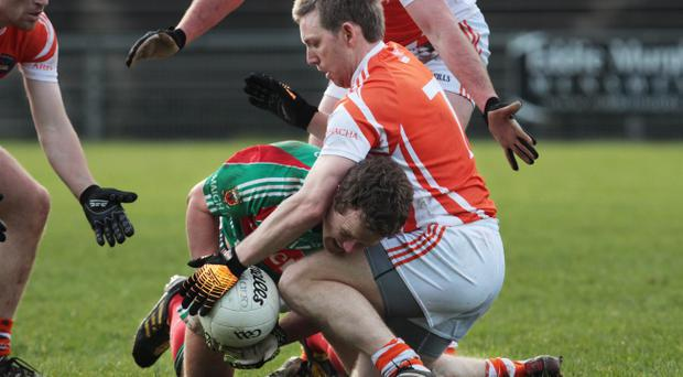 Mayo's Andy Moran is stopped in his tracks by Paul Duffy of Armagh