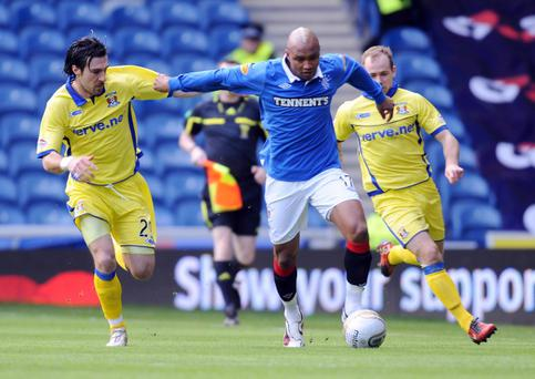 Rangers' El Hadji Diouf is challenged by Kilmarnock's Manuel Pascali (left) and Jamie Hamill during the Clydesdale Scottish Bank Premiership at Ibrox, Glasgow