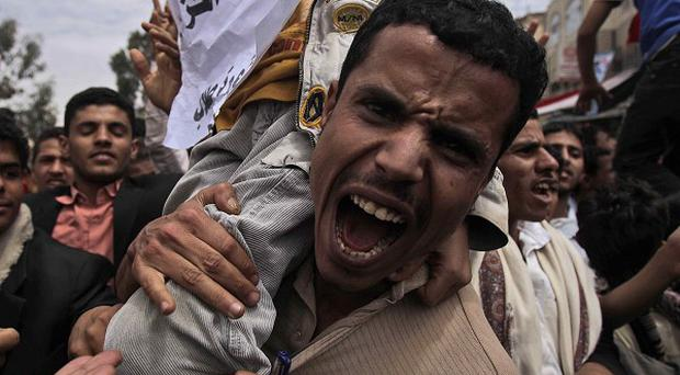 An anti-government protestor shouts during a demonstration demanding the resignation of Yemeni president Ali Abdullah Saleh (AP)