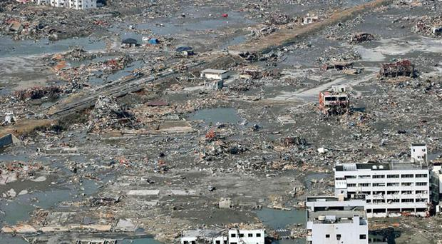 Rubble is scattered across the wide areas of the town of Minami Sanriku, northeastern Japan, on Sunday March 13, 2011, two days after a powerful earthquake and tsunami hit the the country's northeastern coast. (AP Photo/Kyodo News) MANDATORY CREDIT, NO LICENSING ALLOWED IN CHINA, HONG KONG, JAPAN, SOUTH KOREA AND FRANCE