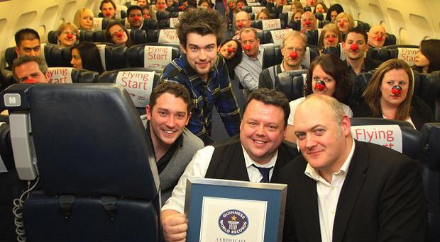 Craig Glenday from Guinness (centre) presents the certificate to comedians Dara O'Briain (right), Jack Whitehall and Jon Richardson (left)