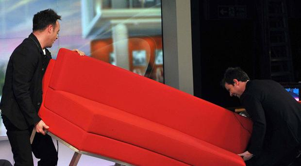 Ant and Dec remove a studio sofa as part of a Comic Relief challenge (BBC)